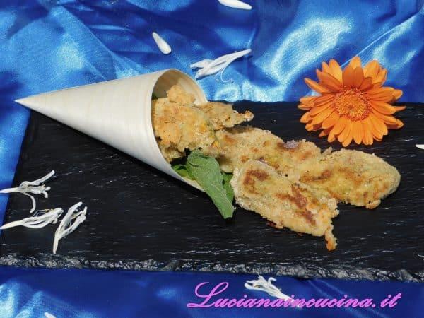 Eccoli qua i nostri fiori  che sembrano fritti ma in realtà sono molto più leggeri. Sono sufficienti un pizzico di sale e uno di pepe e possiamo sederci a tavola.